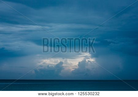 Deep Blue Seascape With Clouds