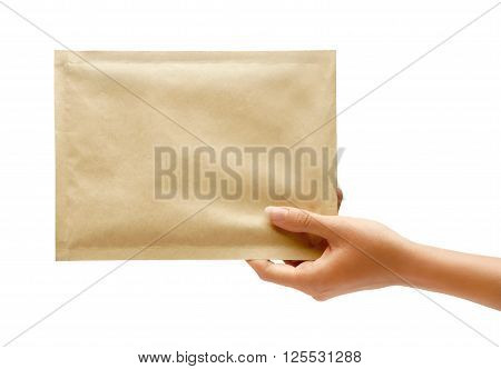 Hand holding envelope. Studio photography of woman's hand holding yellow envelope