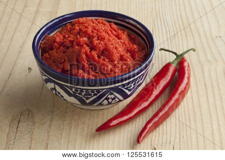 Bowl with Moroccan red harissa and fresh red peppers