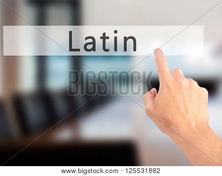 Latin - Hand Pressing A Button On Blurred Background Concept On Visual Screen.