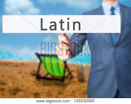 Latin - Businessman Hand Holding Sign