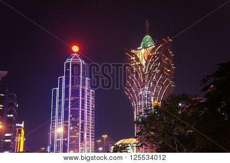 MACAU, MACAU S.A.R. - NOVEMBER 23: The night facades of Grand Lisboa Macau casino resort and Wynn luxury hotels in Macau Peninsula on 23th of November, 2015 in Macau.