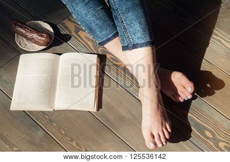 Cozy Photo Of Young Woman Feet With Book And Cake On The Floor