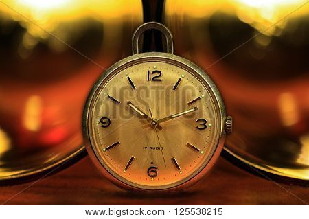 Pocket watch with glasses and golden lights