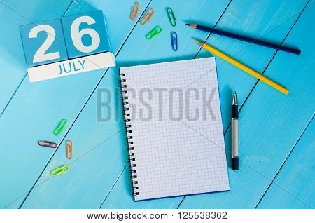 July 26th. Image of july 26 wooden color calendar on blue background. Summer day. Empty space for text. Day Of Esperanto.