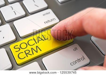 Social Crm Concept - Slim Aluminum Keyboard with Social Crm Button. Man Finger Pressing Social Crm Button on Modern Keyboard. Computer User Presses Social Crm Yellow Keypad. 3D.