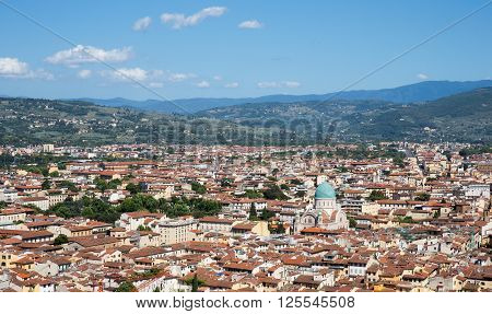 Florence Italy cityscape showing the surrounding hills and the blue-domed Great Synagogue of Florence or Tempio Maggiore. Copy space in sky if needed.