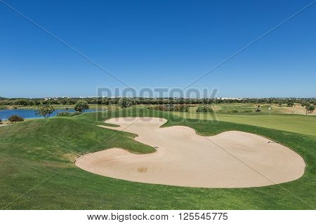 Green lawn for golf. With sand traps.
