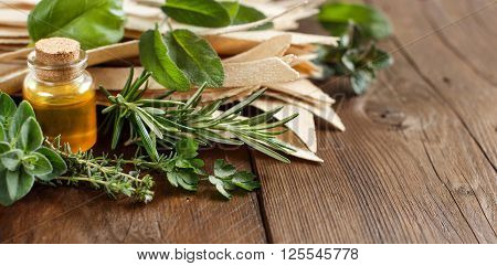 Whole wheat artisan pasta olive oil and herbs on old wooden table
