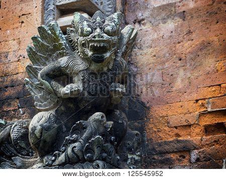Statue of Balinese mythological demon at Monkey Forest Sanctuary temple in Ubud, Bali, Indonesia.