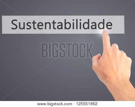 Sustentabilidade (in Portuguese - Sustainability) - Hand Pressing A Button On Blurred Background Con