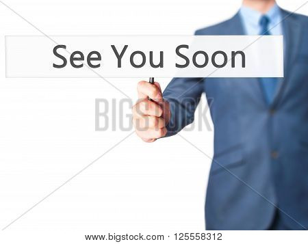 See You Soon - Businessman Hand Holding Sign