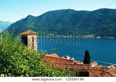 View of the bell tower of Perast (Montenegro) and its roof