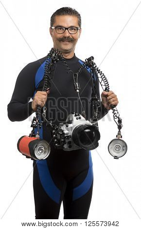 Underwater photographer wearing wet suit isolated on black background.