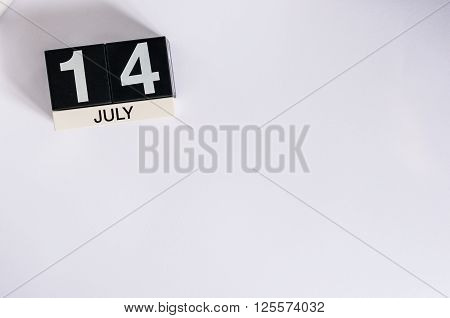 July 14th. Image of july 14 wooden color calendar on white background. Summer day. Empty space for text. Storming of the Bastille Day.