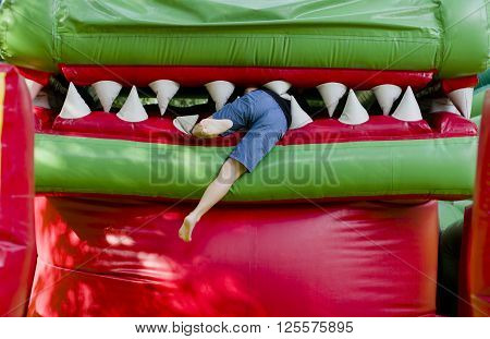 on the Playground child plays - climbs into the dragon's mouth attraction absorption