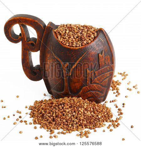 Buckwheat Seeds In A Wooden Bowl. Close