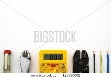 overhead of a electrician equipment in white background
