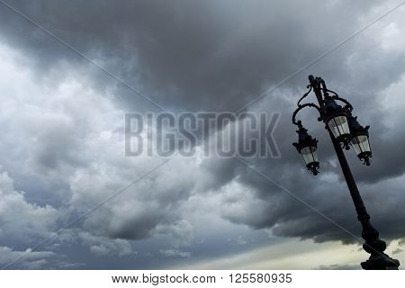 Street lamp and cloudy sky in the city of Bordeaux, France