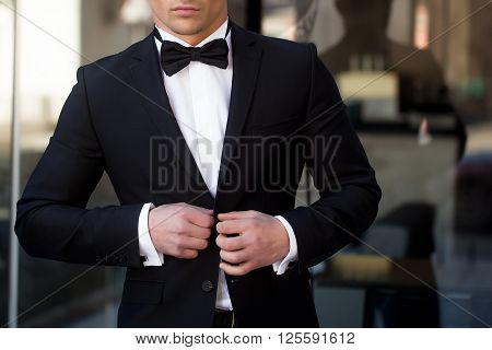 Man Unbuttons Suit Coat