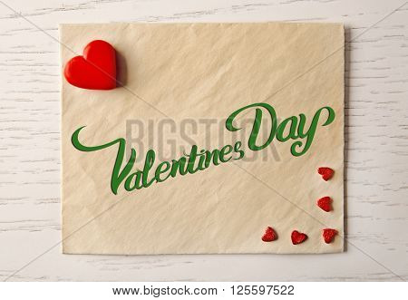 Blank present card with small hearts on wooden background