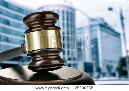 Gavel on building background. Auction concept