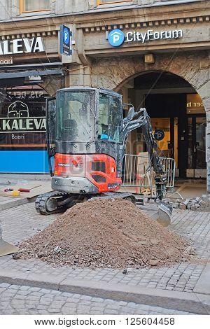 HELSINKI, FINLAND - april, 4, 2016: digger works in Helsinki, Finland.