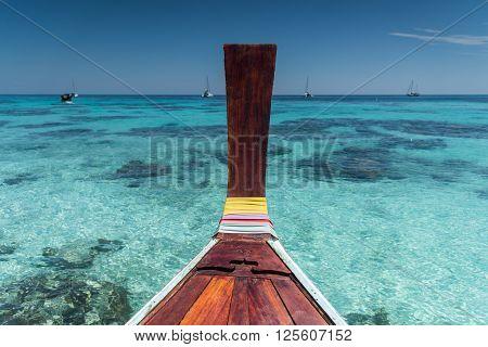 Thai Wooden Head Longtail Boat Heads Toward