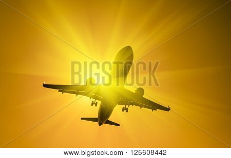 Airplane at take-off with sunbeam on orange background