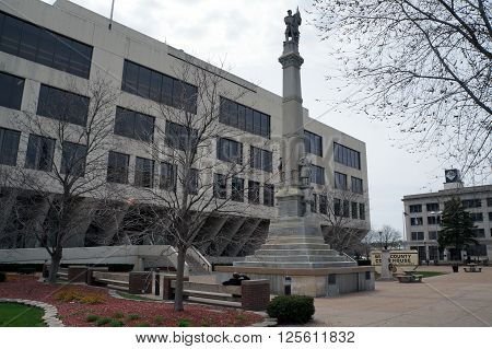 JOLIET, ILLINOIS / UNITED STATES - APRIL 12, 2015:  The Will County Civil War Memorial, aka the Soldiers and Sailors of Civil War Monument, was erected in 1884, and stands in front of the Will County Court House.