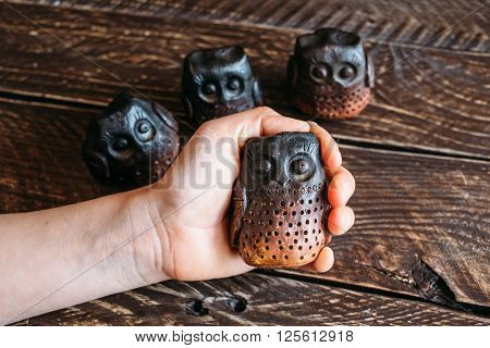 Brown ceramic owls ceramic owl in the palm owls family ceramic owls on a brown background four ceramic owl