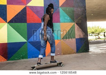 Afro Brazilian girl skateboarding