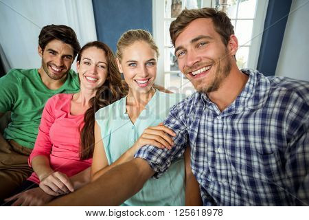 Portrait of smiling happy friends enjoying at home