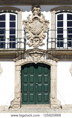 Facade of the Manor of the Vasconcelos with the coat of arms on top of the door in Vila do Conde Portugal