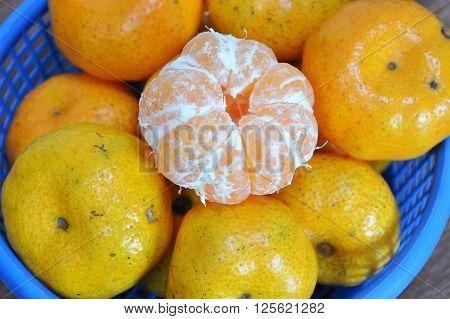 navel orange peel out on blue plastic basket