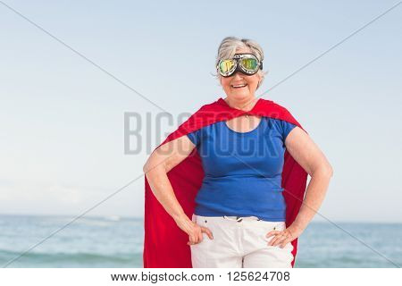 Senior woman wearing superwoman costume on a sunny day