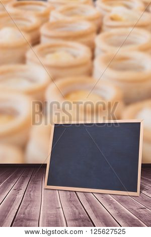 chalkboard against colleagues making vol-au-vent together