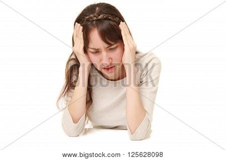 studio shot of depressed woman on white background