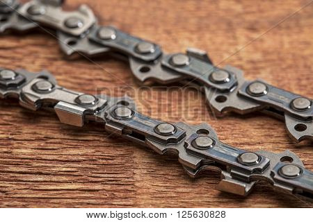 power saw chain detail on a rustic grained wood