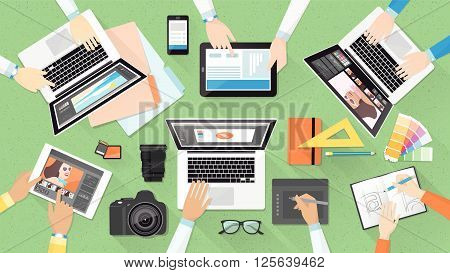 Creative team working together at office desk teamwork and advertising concept