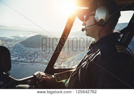 Male Helicopter Pilot Flying Aircraft