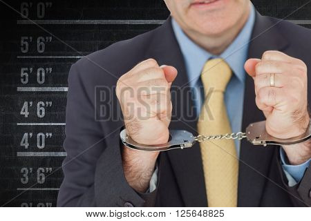 Closeup of businessman with handcuffed hands against digital composite image of height measurement