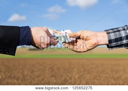 a businessman and farmer with a money transfer