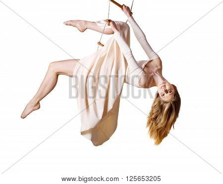 Young Woman Gymnast  On Rope-ladder