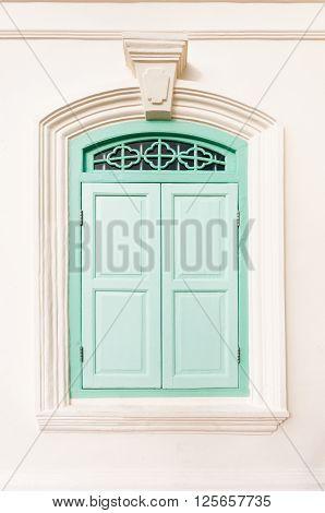 Old retro green sino portuguese style window
