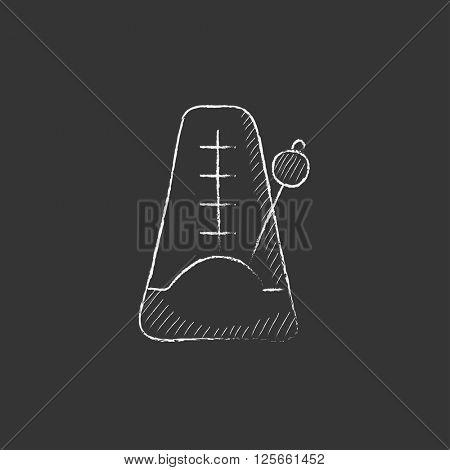 Metronome. Drawn in chalk icon.