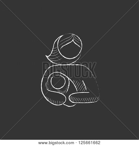 Woman holding baby. Drawn in chalk icon.