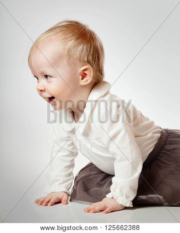 Cute little baby girl over gray background