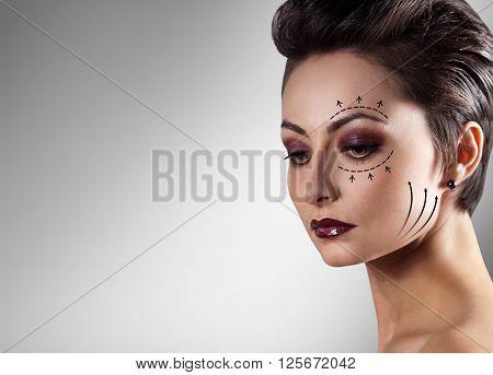 Portrait of beautiful caucasian woman. Plastic surgery and aesthetic medicine concept.