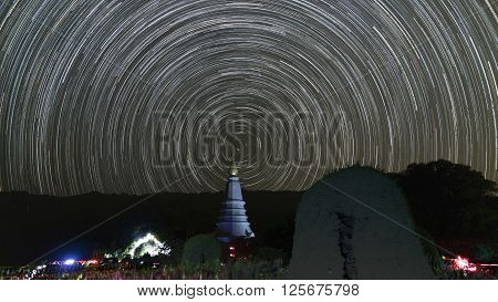 view of asian buddhist pagoda and startrail in galaxy universe poster